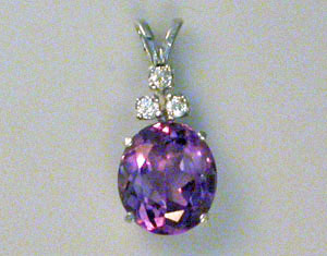 Mountings 1 053 oval 4 prong pendant mounting with three accent stones aloadofball Image collections
